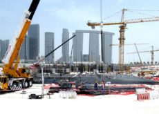 Construction site of Abu Dhabi's Reem Mall project fitted with 13 of 14 tower cranes